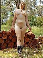 Hairy blond with pierced pussy walks in the woods