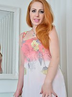 Beautiful redhead Tia Jones takes off her pink nightie to show that hairy pussy